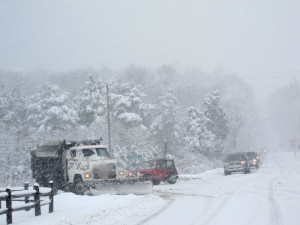 Photo By Heidi Crandall : ©2010 www.nelsoncountylife.com : A driver works with his snow plow to clear the intersection at Route 151 & 664 headed up to Wintergreen.
