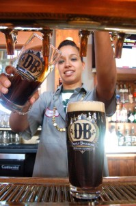 Siporah Winsheimer taps one of Jason's fresly brewed beers at DBBC.
