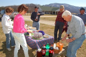 Some of the folks on hand Tuesday enjoyed a picnic style lunch outside in the fantastic weather. The Verandah is seen off in the background.