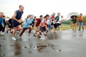 Photos By Tommy Stafford : ©2010 www.nelsoncountylife.com : With rainy skies over Afton, runners in Saturday's 5K race take off!