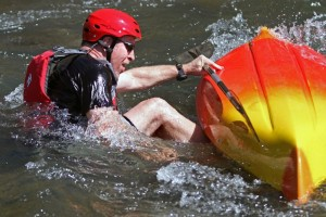 John Fritschi, of Hampton  exits his kayak after flipping at the start of the paddling portion of the Piney River Mini Triathlon held Saturday April 10, 2010.  He quickly dumped the water out of the boat and continued.