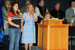 Tonya Bodek (left) and her mother sing the Armed Forces Medley at Sunday's program in Lovingston.