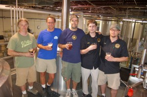 Jacque Landry, (partner & brewer South Street Brewery) Matt Nucci, (brewer and co-owner Blue Mountain Brewery) Mark Thompson, (owner and brewmaster Starr Hill) Aaron Reilly, (brewer Devils Backbone) and Jason Oliver, (head brewmaster Devils Backbone) stand by one of the two tanks of a collaborative brew being made for release at this year's Brew Ridge Trail Music Festival in August.