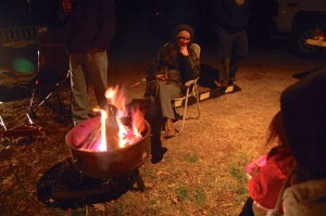 People waiting their turn to bounce huddle around a toasty fire Tuesday night at Bouncing For Turkeys held at Devils Backbone Brewing.