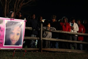 The grieving crowd congregates for the lighting of the tree dedicated to the missing 17-year-old, Alexis Murphy this past Tuesday night - December 3, 2013