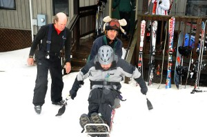 Sam Shaver and Damion Armour assist Michael Murphy on the snow.