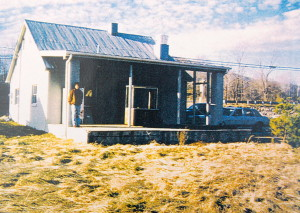 This is what Basic Necessities looked like long before it was the restaurant today. It was a home, a bakery, then Basic Necessities. This is around 1997 shortly before it became Basic. You can see Kay on the far left side of the porch looking toward the camera.