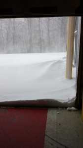 Photo Courtesy Of Curtis Sheets - Chief at Wintergreen Fire & Rescue : With winds howling in excess of 50 MPH at times, 1 foot snow drifts formed outside the WF&R bay doors Sunday morning.
