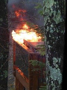 Photo Courtesy of Cathy Knowles: A large fire started in the hot tub area of a home on Ravens Roost Dr. at Wintergreen Friday afternoon April 24, 2014. Fire crews believe a lightning strike from a passing thunderstorm caused the fire.