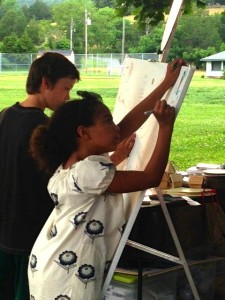 Olivia Trager (R) takes to the easel this past weekend at the annual RVCC membership drive.