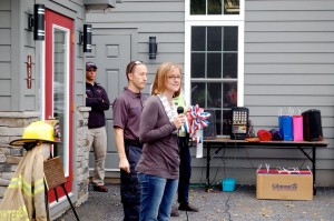 Frank Ott's daughter, Robin, speaks at the Saturday ceremony where the newly renovate Wintergreen Fire Station in Nellysford was dedicated in her late father's memory.