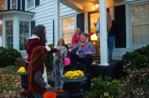 ©2014 Blue Ridge Life : Photos By Tommy Stafford : BRL Publisher Yvette Stafford with the Junior & Juniorette Publishers in tow, thanks one of the dozens of people in Lovingston that rolled out the red carpet for trick or treaters this past Friday night - October 31, 2014