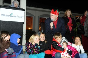 Ron Turnbull recites 'Twas The Night Before Christmas while children look on during the annual tree lighting held this past Wednesday evening - December 3, 2014 at Stoney Creek in Nellysford, VA.