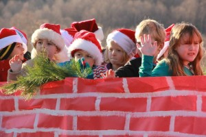 ©2014 Blue Ridge Life Magazine : Photos By BRLM Photographer Shay Munroe : Youngsters wave at the crowd during the annual Christmas Parade held Sunday afternoon - December 7, 2014 in Lovingston, Virginia.