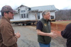 Justin Crandall (left) of Tectonics II Builders in Roseland along with his dad, Steve Crandall (center) discuss the move across the parking lot on Wednesday afternoon - March 11, 2015.