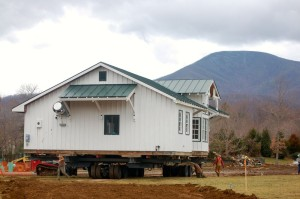 ©2015 Blue Ridge Life Magazine : Photos By Tommy Stafford : The historic Arrington Train Depot that was originally reassembled on the grounds at Devils Backbone  Brewing back in December of 2007 was moved across the parking lot Wednesday afternoon March 11, 2015 as part of the brewery's expansion.