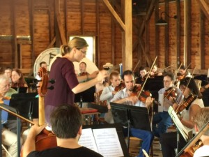 Photo by BRLM Mountain Photographer Paul Purpura : Artistic director Erin Freeman conducts members of the Wintergreen Summer Music Academy and locals who joined in the music in the Rodes Farm Barn, Saturday - July 25, 2015.