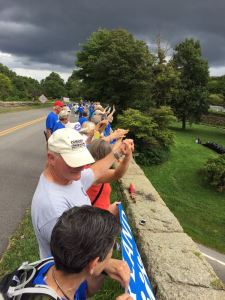 ©2015 Blue Ridge Life Magazine: Photo By Woody Greenberg : As part of Hands To Protect Our Land, dozens of people line the stone bridge crossing over Route 250 on Afton Mountain where it meets Blue Ridge Parkway Tuesday evening - August 19, 2015