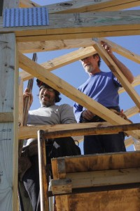 Paul Ackerman and Brian Webb work on part of the framing of the roof at what will become the Blue Mountain Pavilion at RVCC.