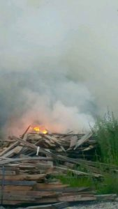 Photo courtesy of Lovingston Vol Fire Dept : Fire burns in a pile of old scrap lumber in an area south of Arrington on Friday evening - May 26, 2014