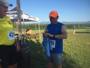 ©2016 Blue Ridge Life Magazine : Photos By Yvette Stafford : Bpb Clouston of Wintergreen gets ready to run the Corkscrew Racing Full Nelson 5K this past Saturday morning - July 22, 2016 at Blue Mountain Barrel House in Arrington, Virginia. The temps were hovering in the lower 80s at racetime.