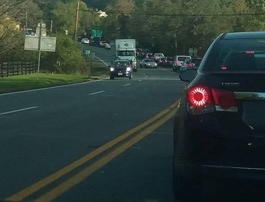 Photo Courtesy of Merrilee Gumm : An accident late Saturday afternoon at the intersection of Route 250 and Route 151 in Western Albemarle County has traffic backed up for a considerable length. Another accident up the mountain on old Route 6 also contributed to the gridlock.