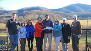 Photo Courtesy of Wintergreen Resort : Pictured l. to r.: Lindsay Dorrier III, Sue Love, Donna McCurdy, Jane Francie, Hank Thiess, Rudy Strickland, Ika Joiner and Joe Steele are all smiles as a check for $3379.41 is presented to the Nelson County Community Fund last week on December 8, 2016.