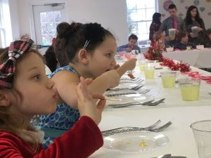 These two young ladies practice a bit of proper dining on Valentine's Day during the etiquette luncheon held this past Tuesday - February 14, 2017 at Afton Christian School in Nelson County.