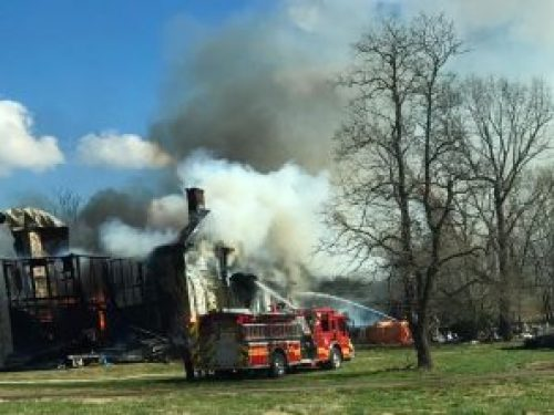 Photo By Carlos Becerra : The house fire as it was nearly extinguished - Friday afternoon - March 3, 2017