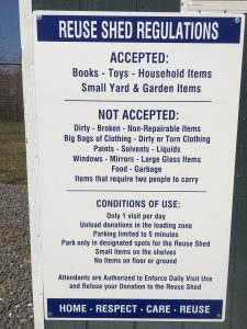 A sign with rules and regulations attached to the left door of the Re-Use shed in Afton / Greenfield. Friday - March 24, 2017. Click to enlarge.
