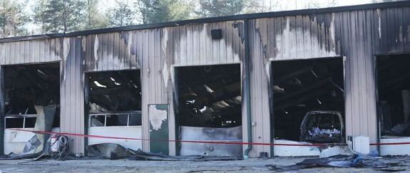 Damage from the fire that destroyed Joe's Garage and several cars in the 12-bay shop.