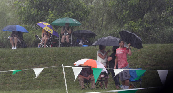 Discus fans and players huddle agains the hard rain that stopped play at the VHSL state track meet in Radford Friday afternoon.