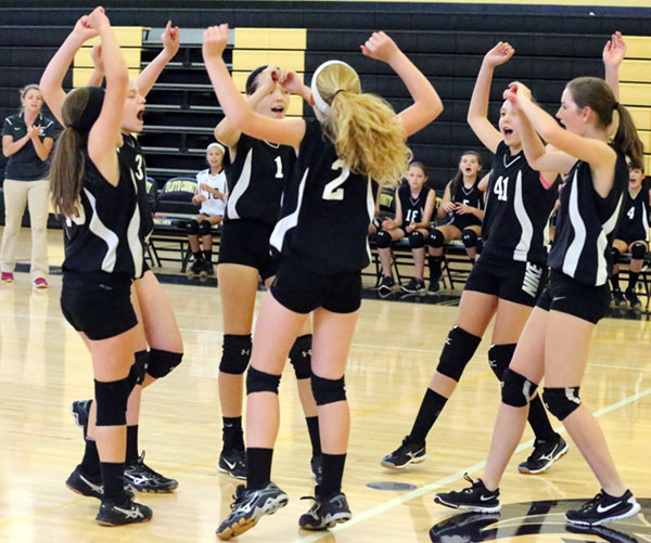 The Middle School Lady Buffs celebrate another point.