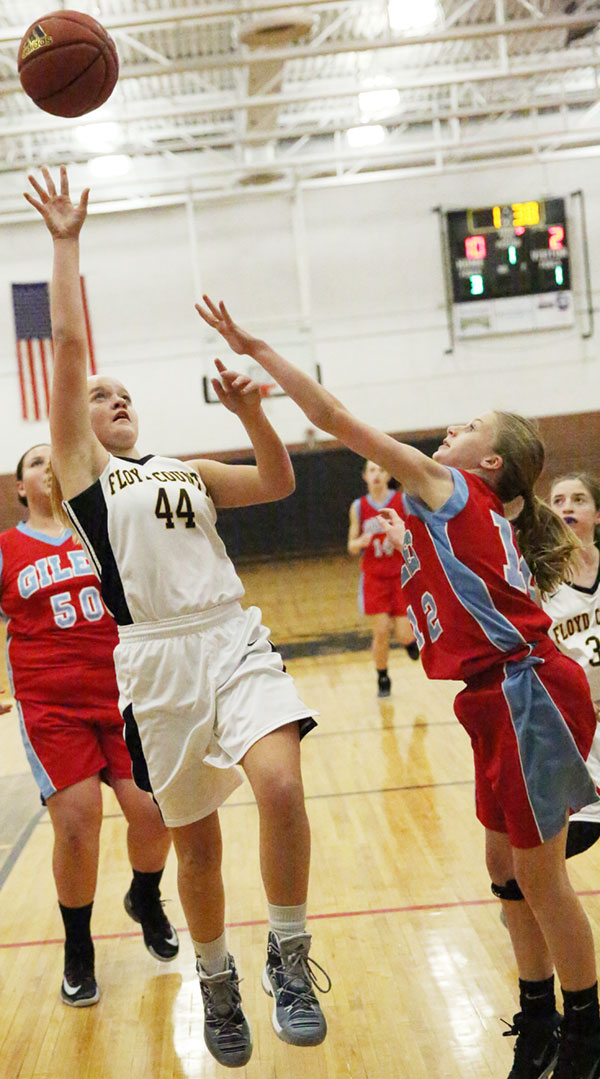 Jaden Nichols of the Lady Buffaloes goes in for a score against Giles.