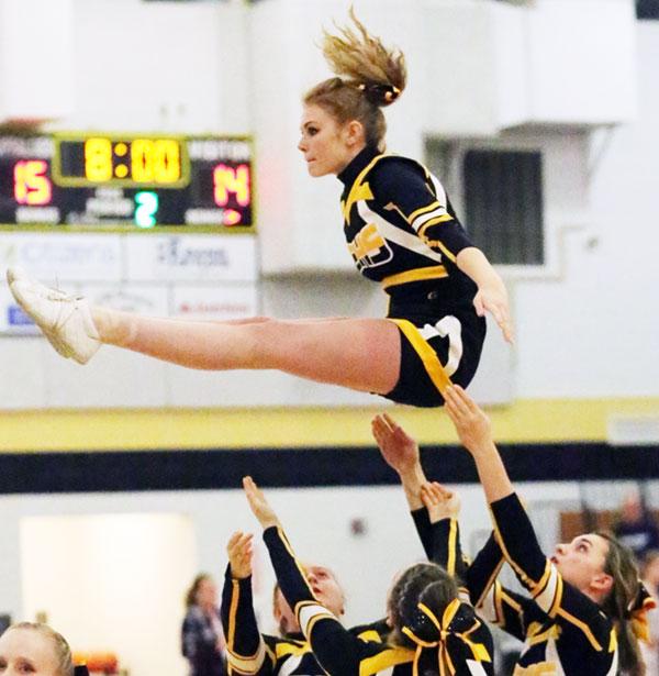 Varsity cheerleaders at work.