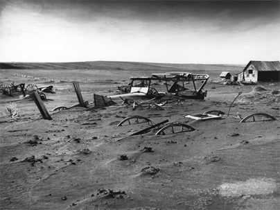 dust covering cars and fences in the dust bowl of the 1930s