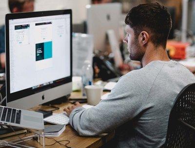 Man Sitting At Desk - Hiring IT Contractors - Blues Point Ltd