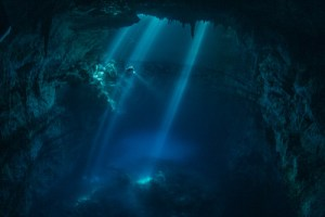 paul-nicklen-lights-enhance-the-cathedral-like-features-of-the-holtun-cenote-as-archaeologists-dive-in