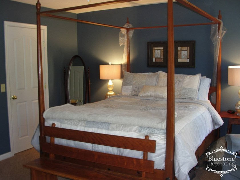 Creating a dreamy master bedroom. A dark, restful color palette is lightened up with shades of silver & white in this Master Bedroom by Crystal Ortiz of Bluestone Decorating