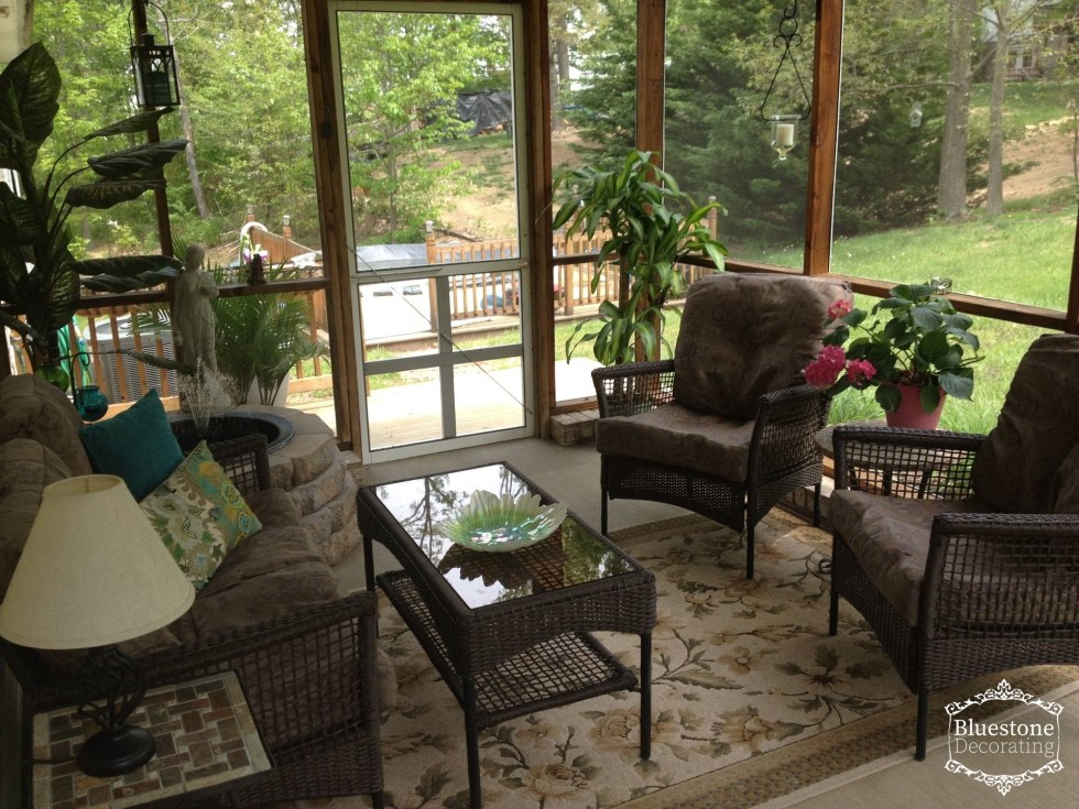 A relaxing screened porch provides outdoor entertaining space and conversation by Crystal Ortiz of Bluestone Decorating