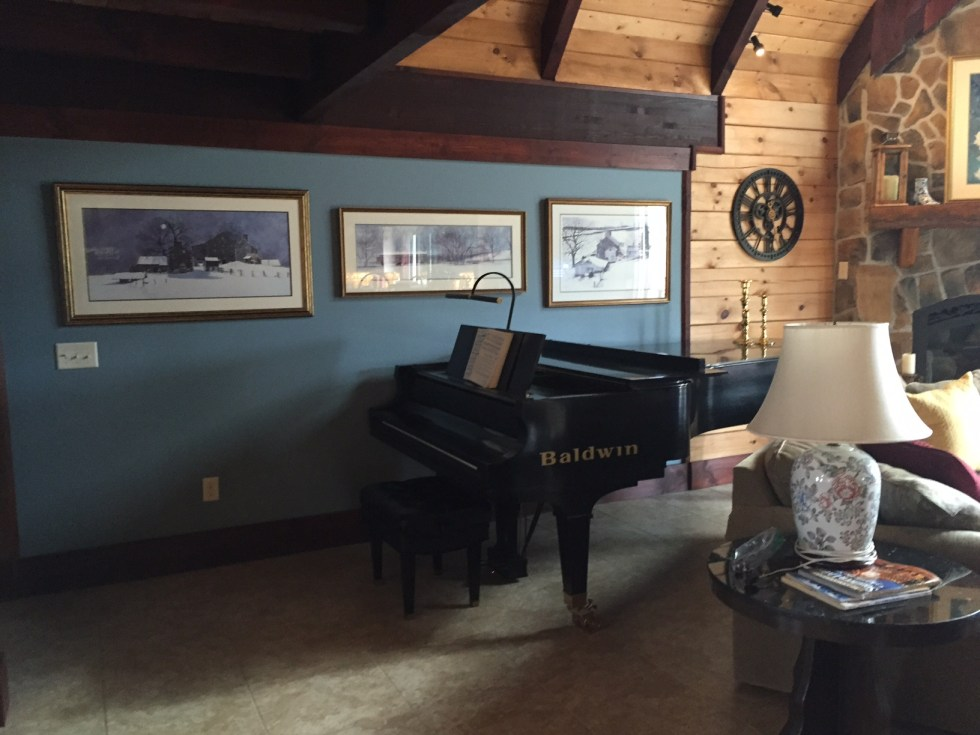 """AFTER: BM """"Wild Blue Yonder"""" on this wall makes the art feel more alive and enhances the log walls in this home."""