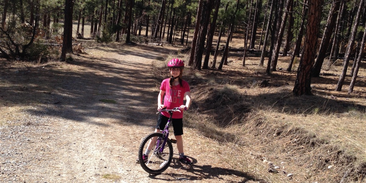Girl on a mountain bike on a trail