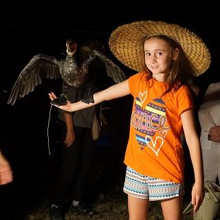 Claire holding a cormorant