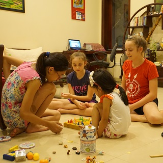 Our girls love playing with our Vietnamese hosts