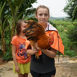 Sophie holds the doomed chicken