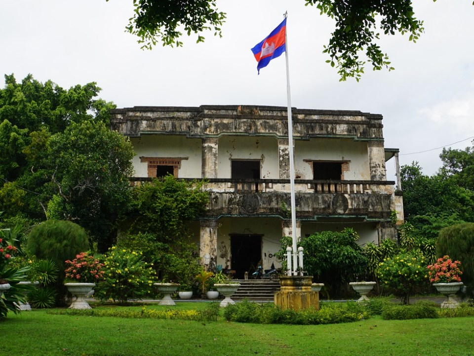 The king's palace is in great need of repairs and still riddled with bullets from Vietnamese artillery