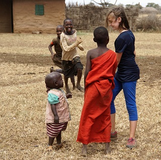 Claire plays with Maasai children