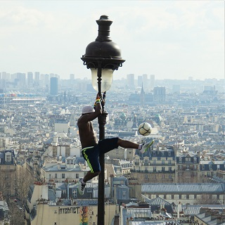 This guy did soccer stunts high above the crowd at Sacre Coeur