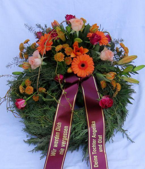 Trauerkranz fr Urnengrab in orange  Blumenspezi
