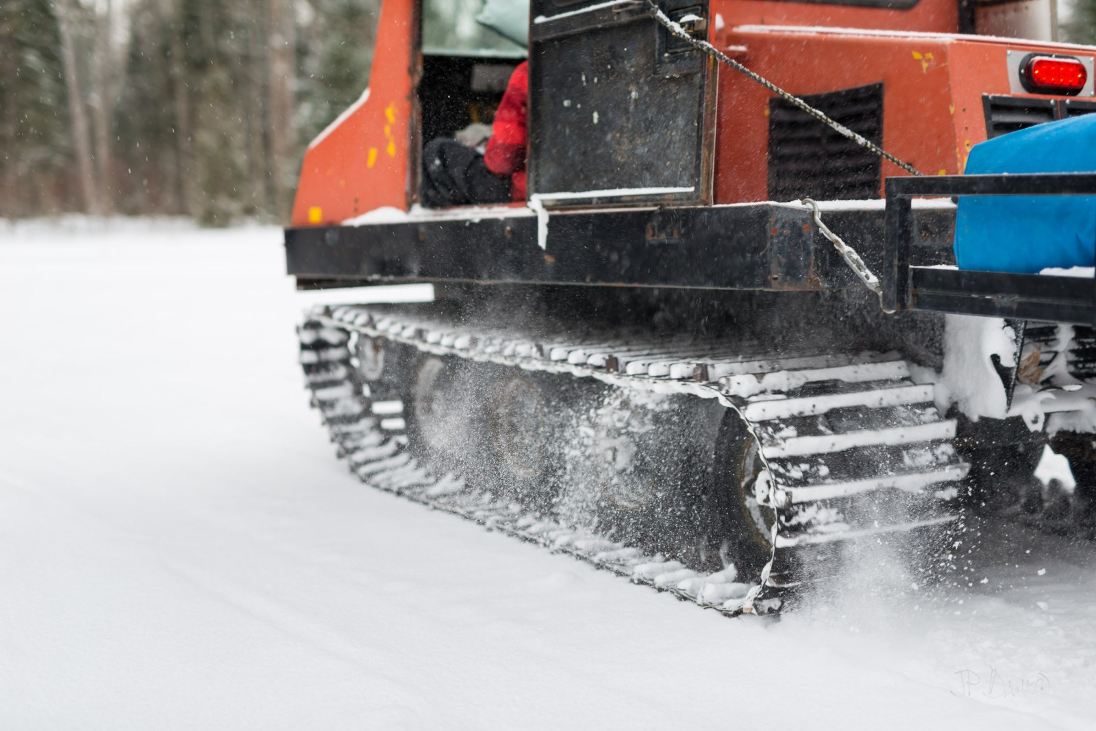 Caterpillar tracks of vintage snow grooming machine get good traction